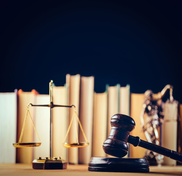Symbols of law - scale, hammer and Themis